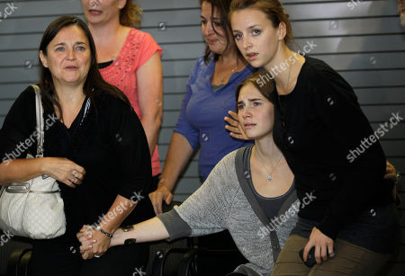 Stock Picture of Amanda Knox Amanda Knox, right, sits with her sister Deanna Knox, right, and her mother, Edda Mellas, left, as they wait to talk to reporters, in Seattle. Knox was freed Monday after an Italian appeals court threw out her murder conviction for the death of her British roommate, Meredith Kercher
