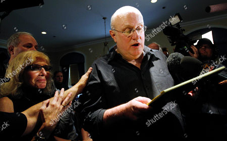 Tom Wright, a friend of Amanda Knox's family, reads a statement after he and a group of supporters learned an Italian appeals court had thrown out the Seattle native's murder conviction in the death of her British roommate, in downtown Seattle