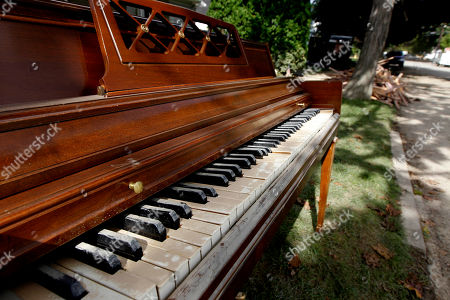 A Wurlitzer piano with a coating of mud on the keys is on the curb for pick up in West Pittston, Pa., where homes were damaged by floodwaters from the Susquehanna River, swollen after the remnants of Tropical Storm Lee came through. While many people in West Pittston did oppose a $25 million levee system when it was discussed a generation ago - among them occupants of the stately riverfront Victorians that line the borough's nicest street, Susquehanna Avenue - it was the U.S. Army Corps of Engineers that made the ultimate decision to leave the borough unprotected