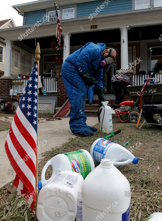Jude Sidari Jude Sidari, with Northeast Biohazard Remediation, refills a spray bottle as he works to clean up a home in West Pittston, Pa., where homes were damaged by floodwaters from the Susquehanna River, swollen after the remnants of Tropical Storm Lee came through. While many people in West Pittston did oppose a $25 million levee system when it was discussed a generation ago - among them occupants of the stately riverfront Victorians that line the borough's nicest street, Susquehanna Avenue - it was the U.S. Army Corps of Engineers that made the ultimate decision to leave the borough unprotected