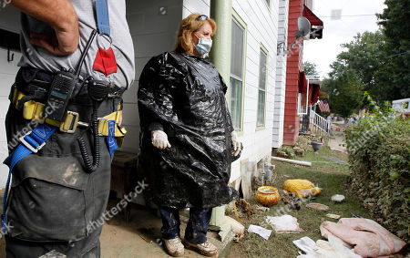 Connie Andrews Connie Andrews wears gloves, a mask, and a trash bag as a firefighter tells her he can't pump out her basement that has mud in it in West Pittston, Pa., where homes were damaged by floodwaters from the Susquehanna River swollen after the remnants of Tropical Storm Lee came through. While many people in West Pittston did oppose a $25 million levee system when it was discussed a generation ago - among them occupants of the stately riverfront Victorians that line the borough's nicest street, Susquehanna Avenue - it was the U.S. Army Corps of Engineers that made the ultimate decision to leave the borough unprotected