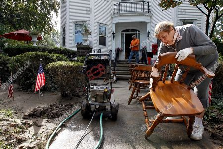 Angela Sperrazza Angela Sperrazza works to clean chairs in front of her home in West Pittston, Pa. Homes were damaged by floodwaters from the Susquehanna River swollen after the remnants of Tropical Storm Lee came through. While many people in West Pittston did oppose a $25 million levee system when it was discussed a generation ago - among them occupants of the stately riverfront Victorians that line the borough's nicest street, Susquehanna Avenue - it was the U.S. Army Corps of Engineers that made the ultimate decision to leave the borough unprotected
