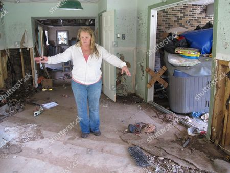 Tami Brown shows the damage inside her home in Plunketts Creek Township, near Williamsport, Pa. Floodwaters following the remnants of Tropical Storm Lee inundated the house