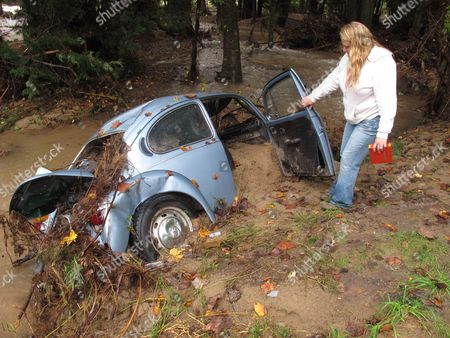 Tami Brown shows the damage to her car after it was washed away from her property in Plunketts Creek Township, near Williamsport, Pa. Foodwaters following the remnants of Tropical Storm Lee inundated her community