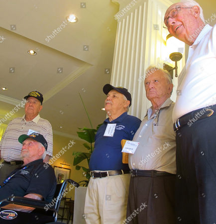 American survivors of the World War II Battle of Leyte Gulf gather in North Charleston, S.C.,, for a reunion of the USS Johnston-Hoel Association. The five, from left, are; John Oracz of Grand Rapids, Mich.; Glenn Parkin, of North Salt Lake City, Utah, in wheelchair; Dusty Rhodes of Winfield, Kan.; George Miller of Taylorsville, N.C., and Larry Morris of Harrodsburg, Ky., All survived more than 50 hours in shark-infested waters after their destroyers were sunk by the Japanese fleet