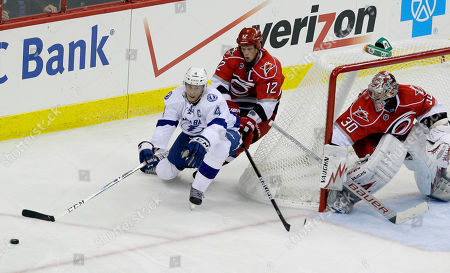 Cam Ward, Eric Staal, Vincent Lecavalier Tampa Bay Lightning's Vincent Lecavalier (4) tries to shoot as Carolina Hurricanes' Eric Staal (12) and goalie Cam Ward (30) defend during the third period of an NHL hockey game in Raleigh, N.C., . Tampa Bay won 5-1