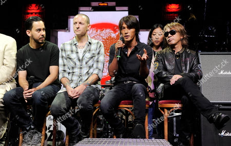 Mike Shinoda, Chester Bennington, Tak Matsumoto, Koshi Inaba Mike Shinoda, far left, and Chester Bennington, second from left, of the band Linkin Park are joined by Koshi Inaba, second from right, and Tak Matsumoto of the Japanese band B'z during a news conference at the Mayan Theater in Los Angeles, . The two bands employed social networking to challenge their fans to raise money for Japan tsunami relief. Fans that raised at least $500 gained access to a private concert Wednesday featuring both bands