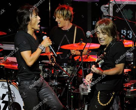 Koshi Inaba, Tak Matsumoto Koshi Inaba, left, and Tak Matsumoto, right, of the Japanest band B'z perform during a private concert at the Mayan Theater in Los Angeles, . B'z and American band Linkin Park employed social networking to challenge their fans to raise money for Japan tsunami relief. Fans that raised at least $500 gained access to the private concert featuring both bands