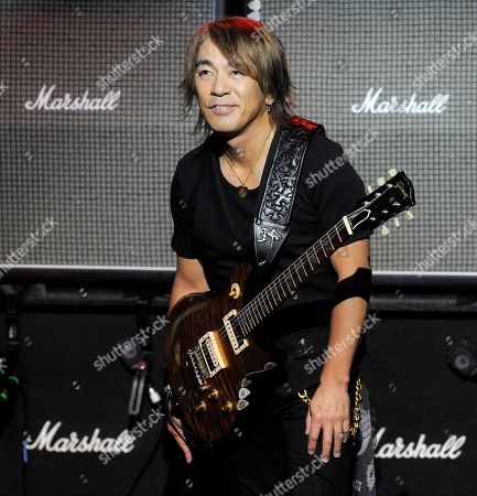 Tak Matsumoto Tak Matsumoto of the Japanese band B'z performs during a private concert at the Mayan Theater in Los Angeles, . Linkin Park, along with B'z, employed social networking to challenge their fans to raise money for Japan tsunami relief. Fans that raised at least $500 gained access to the private concert featuring both bands