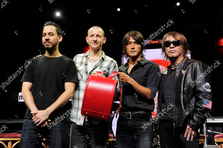 Stock Picture of Mike Shinoda, Chester Bennington, Tak Matsumoto, Koshi Inaba Mike Shinoda, far left, and Chester Bennington, second from left, of the band Linkin Park, and Koshi Inaba, second from right, and Tak Matsumoto of the Japanese band B'z pose with a child's backpack at a news conference at the Mayan Theater in Los Angeles, . The two bands employed social networking to challenge their fans to raise money for Japan tsunami relief. Fans that raised at least $500 gained access to the private concert featuring both bands