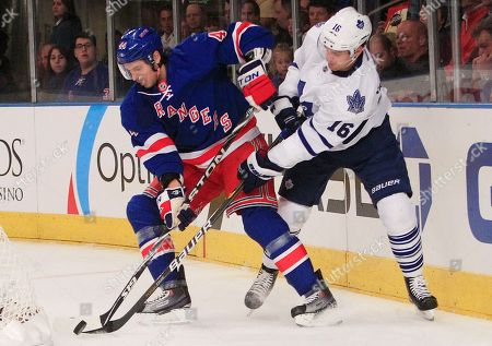 Steve Eminger, Clarke MacArthur New York Rangers' Steve Eminger (44) fights for control of the puck with Toronto Maple Leafs' Clarke MacArthur (16) during the first period of an NHL hockey game, in New York