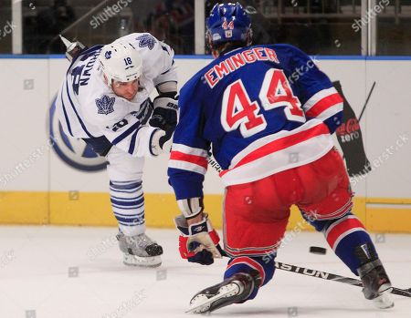 Mike Brown Toronto Maple Leafs' Mike Brown (18) shoots the puck past New York Rangers' Steve Eminger (44) to score during the third period of an NHL hockey game, in New York. The Maple Leafs won the game 4-2