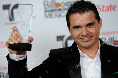 Horacio Palencia Cisneros Horacio Palencia Cisneros poses backstage with the award for songwriter of the year at the first annual Mexican Billboard Awards, in Los Angeles