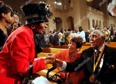 Joseph E. Lowery, Christine King Farris, Evelyn G. Lowery Christine King Farris, left, the only living sibling of Dr. Martin Luther King, Jr., greets Rev. Joseph E. Lowery, right, ad his wife Evelyn G. Lowery, after a prayer service in honor of Dr. Martin Luther King, Jr., at the Basilica of the National Shrine of the Immaculate Conception, in Washington, on