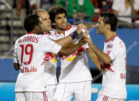 Dane Richards, Mehdi Ballouchy, Rafa Marquez, Joel Lindpere New York Red Bulls' Dane Richards (19), Mehdi Ballouchy, third from left, and Rafa Marquez, right, celebrate with Joel Lindpere, second from left, following his goal against FC Dallas in the second half of an MLS Cup match, in Frisco, Texas. The Red Bulls won 2-0