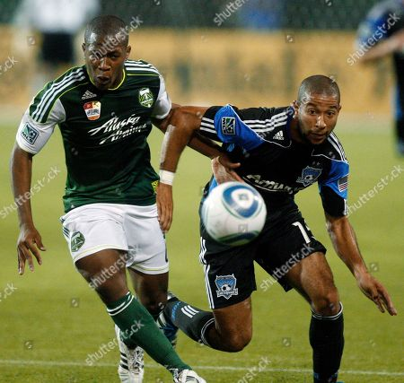 Darlington Nagbe, Justin Morrow Portland Timbers' Darlington Nagbe, left, and San Jose Earthquakes' Justin Morrow (15) go after a ball in the first half during an MLS soccer game, in Portland, Ore