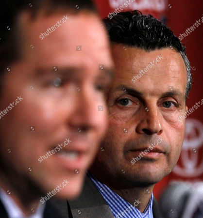 Frank Klopas, Andrew Hauptman Frank Klopas, right, listens as Chicago Fire owner Andrew Hauptman speaks after naming Klopas the new head coach of the soccer team during a news conference, in Bridgeview, Ill