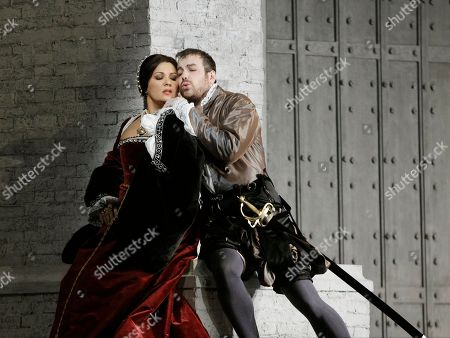 "Anna Netrebko, Stephen Costello Anna Netrebko, left, portrays Anne Boleyn with Stephen Costello as Lord Richard Percy during the final full dress rehearsal for Gaetano Donizetti's ""Anna Bolena,"" at the Metropolitan Opera in New York. Monday, Sept. 26 was opening night of the company's 2011-12 season"
