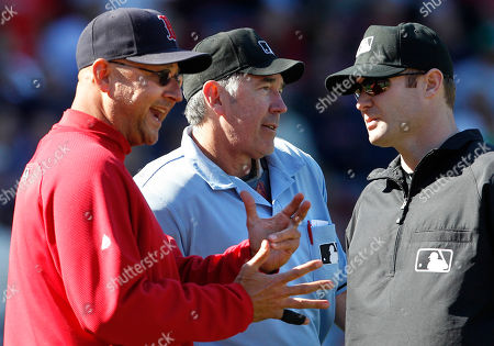 Terry Francona, Mike Winters, Mike Estabrook Boston Red Sox manager Terry Francona, left, argues with home plate umpire Mike Winters, center, and first base umpire Mike Estabrook, right, after a David Ortiz fly ball to right was ruled foul in the fifth inning of the first game of a day-night doubleheader baseball game against the Baltimore Orioles in Boston