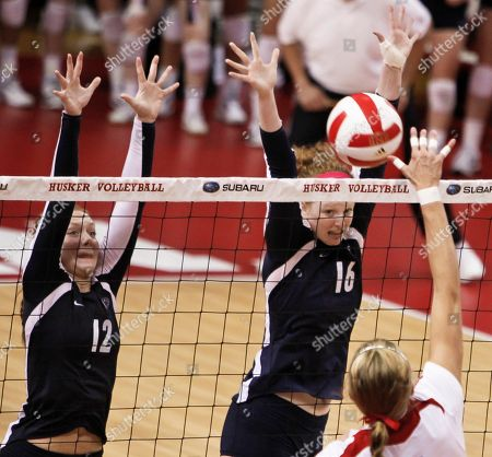Micha Hancock, Katie Slay, Gina Mancuso Nebraska's Gina Mancuso, bottom right, goes for a kill against Penn State's Micha Hancock (12) and Katie Slay (16) in an NCAA college volleyball match in Lincoln, Neb., . Mancuso had 22 kills and Morgan Broekhuis had 12 as Nebraska defeated four-time defending national champion Penn State in five sets in the highly anticipated Big Ten opener for both teams on Wednesday night