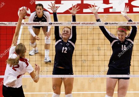 Morgan Broekhuis, Micha Hancock, Katie Slay, Kristin Carpenter Nebraska's Morgan Broekhuis, left, goes for a kill against blocking Penn State players Micha Hancock (12), Katie Slay (16) and Kristin Carpenter, back left, during an NCAA college volleyball match in Lincoln, Neb. Penn State has already lost five matches this season after losing just seven over its four-year NCAA title run, putting them in the position of underdog when they meet top-ranked Nebraska on Saturday, Oct. 29