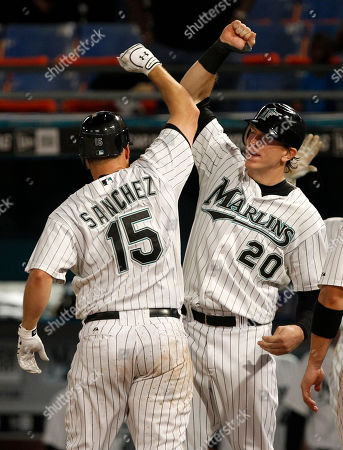 Gaby Sanchez, Logan Morrison Florida Marlins' Gaby Sanchez (15) is met by teammate Logan Morrison (20) after scoring on a three-run home run in the eighth inning of a baseball game against the Philadelphia Phillies in Miami