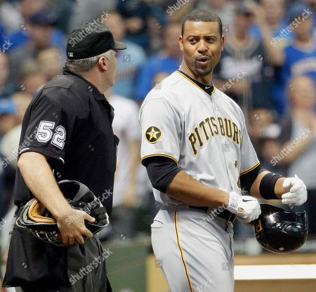 Derrek Lee, Bill Welke Pittsburgh Pirates' Derrek Lee, right, argues with home plate umpire Bill Welke after striking out during the eighth inning of a baseball game against the Milwaukee Brewers, in Milwaukee