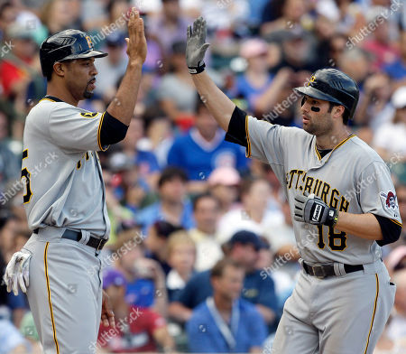 Neil Walker, Derrek Lee Pittsburgh Pirates' Neil Walker, right, celebrates with teammate Derrek Lee after hitting a two-run home run during the eighth inning of a baseball game against the Chicago Cubs, in Chicago