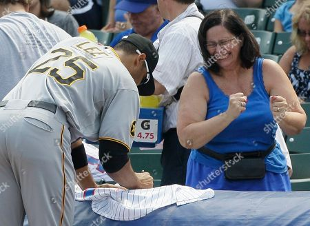 Derrek Lee Pittsburgh Pirates' Derrek Lee, left, signs an autograph for a fan before a baseball game against the Chicago Cubs, in Chicago