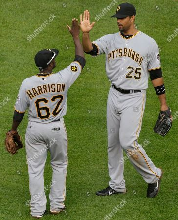 Derrek Lee, Josh Harrison Pittsburgh Pirates' Derrek Lee, right, celebrates with Josh Harrison after the Pirates defeated the Chicago Cubs 7-5 in a baseball game, in Chicago