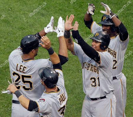 Derrek Lee, Xavier Paul, Jose Tabata, Andrew McCutchen Pittsburgh Pirates' Derrek Lee (25) celebrates with teammates Xavier Paul (38), Jose Tabata (31) and Andrew McCutchen (22) after hitting a grand slam during the ninth inning of a baseball game against the Chicago Cubs, in Chicago. The Pirates won 7-5