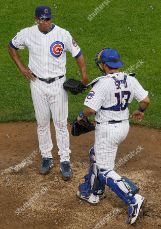 Geovany Soto, Carlos Marmol Chicago Cubs catcher Geovany Soto, right, talks to relief pitcher Carlos Marmol after the Pirates' Derrek Lee hit a grand slam during the ninth inning of a baseball game, in Chicago. The Pirates won 7-5