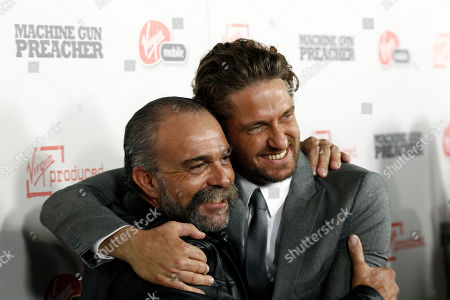 "Stock Picture of Gerard Butler, Sam Childers Cast member Gerard Butler, right, and Sam Childers, whose life is the inspiration for the film and is portrayed by Butler, pose together at the premiere of ""Machine Gun Preacher"" in Beverly Hills, Calif., . ""Machine Gun Preacher"" opens in theaters Sept. 23, 2011"