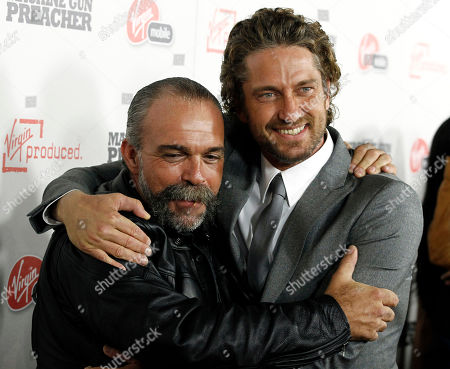 "Gerard Butler, Sam Childers Cast member Gerard Butler, right, and Sam Childers, whose life is the inspiration for the film and is portrayed by Butler, pose together at the premiere of ""Machine Gun Preacher"" in Beverly Hills, Calif., . ""Machine Gun Preacher"" opens in theaters Sept. 23, 2011"