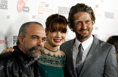 "Gerard Butler, Sam Childers, Michelle Monaghan Cast members Gerard Butler, right, Michelle Monaghan, center, and Sam Childers, whose life is the inspiration for the film and is portrayed by Butler, pose together at the premiere of ""Machine Gun Preacher"" in Beverly Hills, Calif., . ""Machine Gun Preacher"" opens in theaters Sept. 23, 2011"