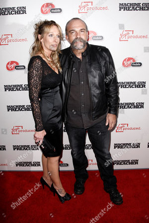 "Stock Photo of Sam Childers, Lynn Childers Sam Childers, whose life is the inspiration for the film, right, and Lynn Childers arrive at the premiere of ""Machine Gun Preacher"" in Beverly Hills, Calif., . ""Machine Gun Preacher"" opens in theaters Sept. 23, 2011"