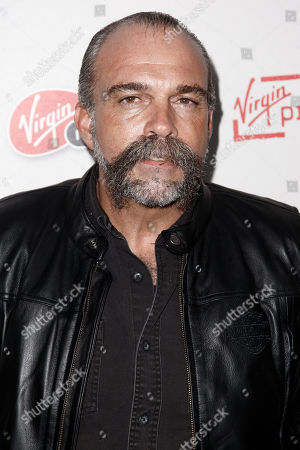 "Sam Childers Sam Childers, whose life is the inspiration for the film, arrives at the premiere of ""Machine Gun Preacher"" in Beverly Hills, Calif., . ""Machine Gun Preacher"" opens in theaters Sept. 23, 2011"