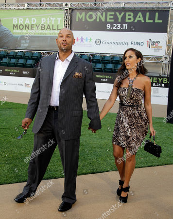"""Rebecca and David Justice Former Oakland Athletics' player David Justice arrives at the Paramount Theatre of the Arts with his wife Rebecca for the premiere screening of the movie """"Moneyball"""", in Oakland, Calif"""