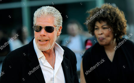 """Ron Perlman, Opal Perlman Ron Perlman, left, a cast member in """"Sons of Anarchy,"""" arrives with his wife Opal before a screening of the fourth season premiere of the television series, in Los Angeles. The premiere is set on air on the FX network on Sept. 6"""