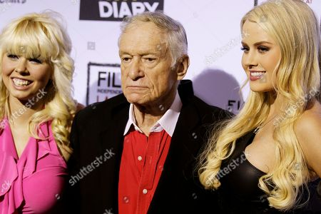 """Hugh Hefner, Shera Bechard, Anna Sophia Berglund Hugh Hefner, center, Shera Bechard, right, and Anna Sophia Berglund arrives at the premiere of """"The Rum Diary"""" in Los Angeles, . """"The Rum Diary"""" opens in theaters Oct. 28, 2011"""