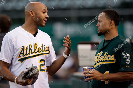 Coco Crisp, Stephen Bishop Oakland Athletics Coco Crisp, right, speaks with actor Stephen Bishop prior to the baseball game against the Texas Rangers, in Oakland, Calif. Bishop portrays former Oakland Athletic David Justice in the film 'Moneyball