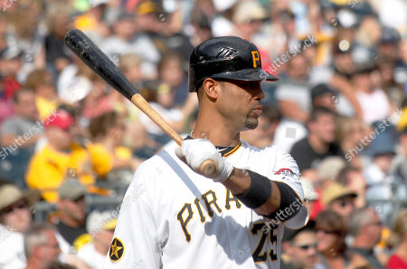 Derrek Lee Pittsburgh Pirates' Derrek Lee (25) plays in the dugout in the baseball game between the Pittsburgh Pirates and the Cincinnati Reds, in Pittsburgh. The reds won 5-4
