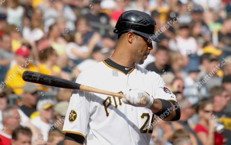 Stock Picture of Derrek Lee Pittsburgh Pirates' Derrek Lee (25) plays in the dugout in the baseball game between the Pittsburgh Pirates and the Cincinnati Reds, in Pittsburgh. The reds won 5-4