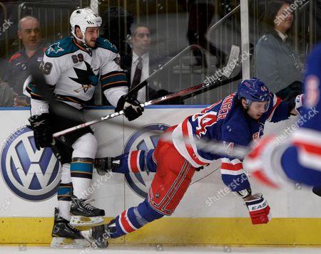 Andrew Desjardins, Steve Eminger San Jose Sharks center Andrew Desjardins (69) sends New York Rangers defenseman Steve Eminger (44) flying in the third period of their NHL hockey game at Madison Square Garden in New York
