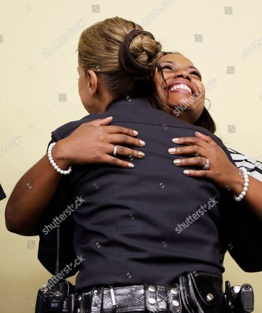 Lora King, Ruby Flores Rodney King's daughter Lora King, 32, and Los Angeles Police Capt. Ruby Flores embrace as they meet with a group of young people who have had their own run-ins with police at a meeting of the Los Angeles Conservation Corps, which provides at-risk youth with job training, education and work, in downtown Los Angeles . She was just 7 when her father was beaten by the Los Angeles Police Department. Her message: It's more important to build bridges with officers than to stand against the, and that a whole police department can't be judged by the actions of a few