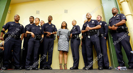 Lora King Rodney King's daughter Lora King, 32, stands shoulder-to-shoulder with a group of Los Angeles Police Officers as they meet with a group of young people who have had their own run-ins with police at a meeting of the Los Angeles Conservation Corps, which provides at-risk youth with job training, education and work, in downtown Los Angeles . She was just 7 when her father was beaten by the LAPD. Her message: It's more important to build bridges with officers than to stand against the, and that a whole police department can't be judged by the actions of a few