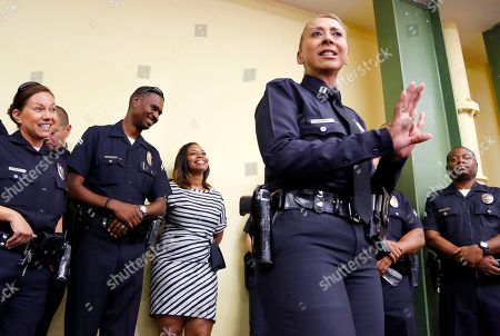 Lora King, Ruby Flores Rodney King's daughter Lora King, 32, center rear, listens as Los Angeles Police Capt. Ruby Flores, right speaks during a meeting with a group of young people who have had their own run-ins with police at a meeting of the Los Angeles Conservation Corps, which provides at-risk youth with job training, education and work, in downtown Los Angeles . She was just 7 when her father was beaten bloody by the Los Angeles Police Department. Her message: It's more important to build bridges with officers than to stand against the, and that a whole police department can't be judged by the actions of a few