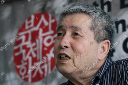 """Im Kwon-taek South Korean director Im Kwon-taek speaks at an interview with The Associated Press during the Busan International Film Festival in Busan, South Korea, . Im said he did not imagine he would be so successful when he was a boy selling combat boots on the streets of Busan while the city was besieged by North Korean forces in a 1950 attack. The letters at left read, """"Busan International Film Festival"""