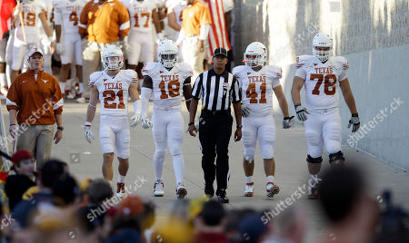 Blake Gideon, Emmanuel Acho, Jamison Berryhill, David Snow Texas' Blake Gideon (21), Emmanuel Acho (18), Jamison Berryhill (41) and David Snow (78) walk to the field before an NCAA college football game against Iowa State, in Ames, Iowa