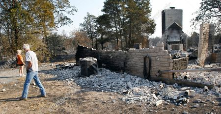 James Whitaker James Whitaker walks around his home that burned when wildfires swept through the area, in Bastrop, Texas. More than 1,000 homes have burned in at least 57 wildfires across rain-starved Texas, officials said Tuesday